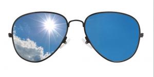 Sunglasses reflecting the sun