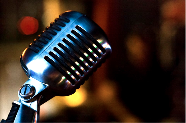 Ron Navarrete photo critique close up of a microphone with a chrome finish and bokeh in the background