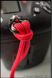 close up of red cord used as a strap