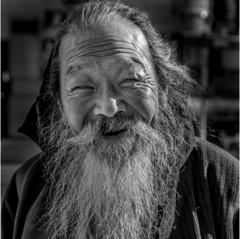 black and white photo of an old man in Shinjuku Japan