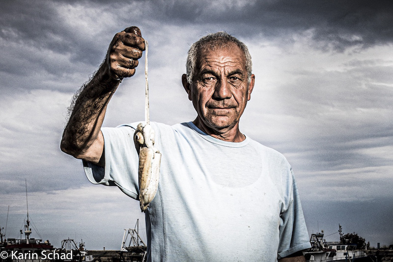 Man with small fish by Karin Schad