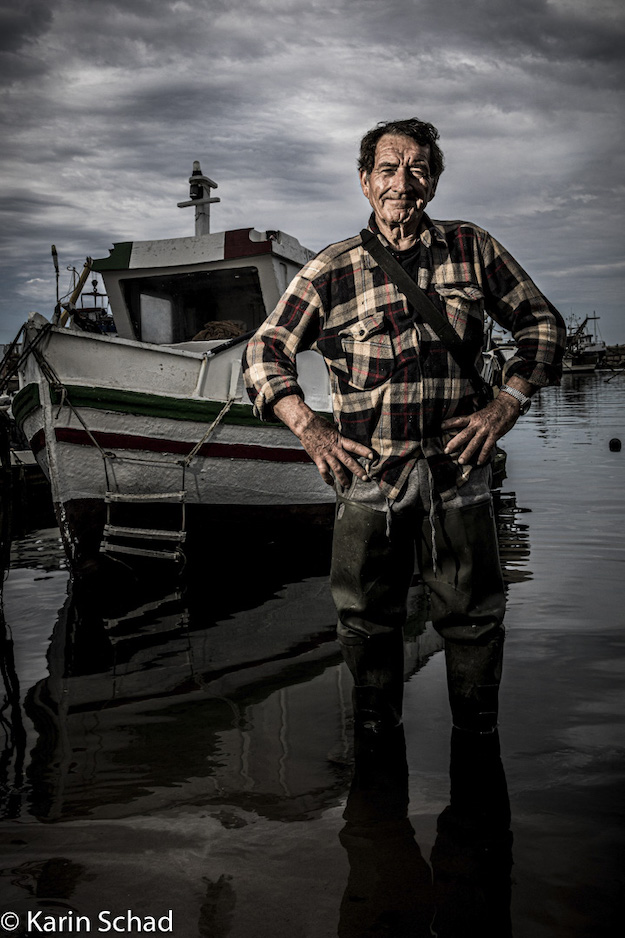 Man in front of a boat by Karin Schad