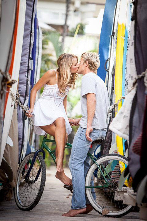 two white people on a bike kissing